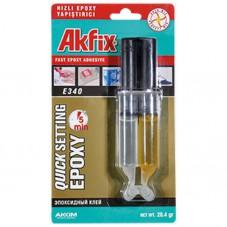 Клей эпоксидный в шприцах Akfix E340, (28, 4 г). Предназначен для склеивания стекла, фарфора, керамики, дерева, стали, алюминия, оргстекла, камня, мрамора, бетона. Время застывания - 5 мин.